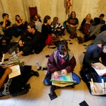 Students gather inside Nassau Hall during a sit-in Nov. 19 in Princeton, N.J. The protesters from a group called the Black Justice League, who staged a sit-in inside university President Christopher Eisgruber's office on Tuesday, demand the school remove the name of former school president and U.S. President Woodrow Wilson from programs and buildings over what they said was his racist legacy.