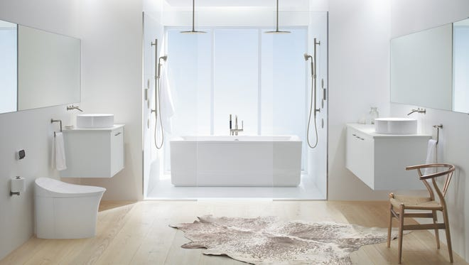 This model bathroom from Kohler features two separate free-standing Jute vanities.