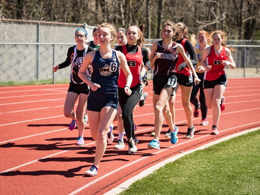 The girls 1,600-meter race at the Caravel Invitational