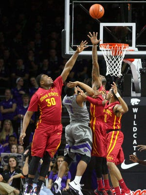 Kansas State Wildcats guard Carlbe Ervin (1) puts up a shot against Iowa State Cyclones guards Deonte Burton (30) and Monte Morris (11) and forward Abdel Nader (2) during first-half action at Fred Bramlage Coliseum. The Cyclones won the game, 76-63.