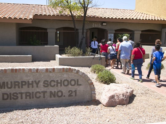 Parents and children walk into the Murphy Elementary