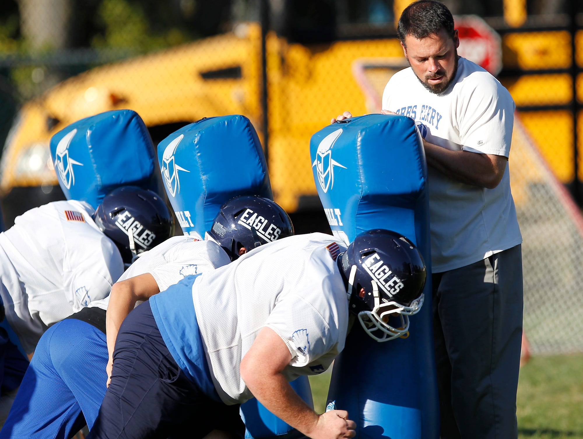 Dobbs Ferry football head coach Jim Moran instructs players during practice on Tuesday, Oct. 20, 2015.