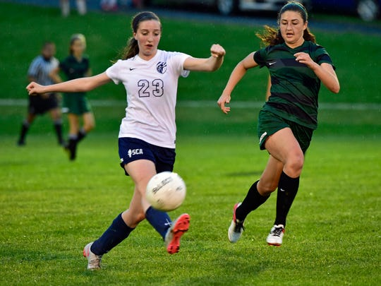 Lydia Harris of Shalom Christian (23) dribbles the ball ahead of Abi Beaty of Shenandoah Valley. Shalom was defeated 4-1 by the Patriots in the MDCC girls soccer championship game on Monday.