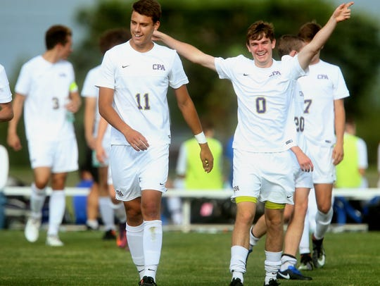 CPA players celebrate Tuesday's 2-0 win over Central