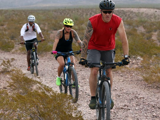 Mountain bikers ride a trail near Lost Dog Trailhead