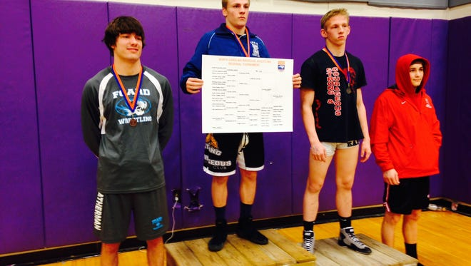 Enka's Michael Cantrell (145 pounds) was an individual champion at last week's 3-A Western Regional tournament in Hendersonville.