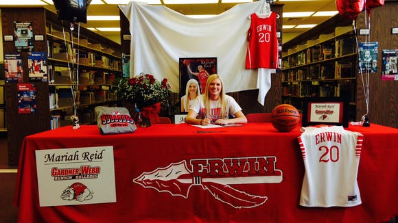 Erwin senior Mariah Reid has sign to play college basketball for Gardner-Webb.