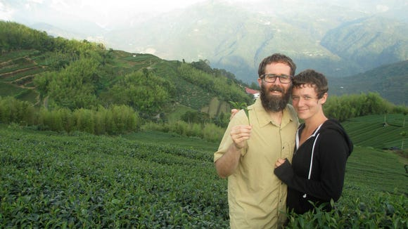 Snavely and Thomas in a tea field in Taiwan.