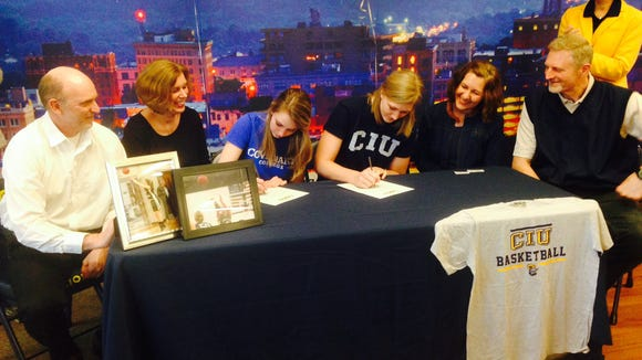 Asheville Christian Academy's Taylor Robinson and Moriah Siemens signed to play college basketball on Wednesday.