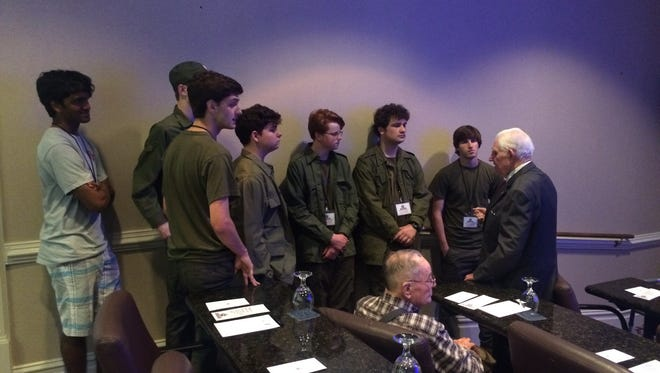 Members of the Jackson Prep drama club, dressed in their costume for next week's M*A*S*H production, speak with WWII POW Earl Derrington of Vicksburg.