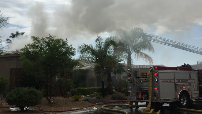 A fire damaged a home near Fountain Hills and Shea boulevards on April 24, 2015.