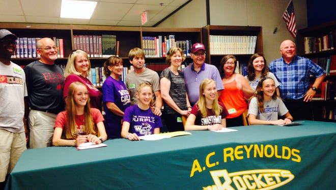 Reynolds seniors Kenzie Himelein-Wachowiak, Emily Cooper, Christen Ray and Lana Reeves signed with college track programs on Monday.