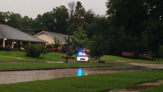 High water floods a portion of Fern Street Thursday.