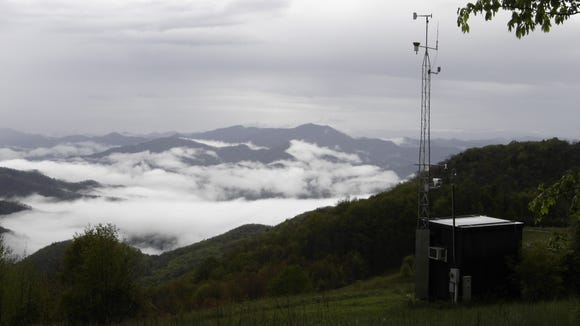 Air quality monitoring station. Air quality officials issued a Code Orange advisory today for air pollution in parts of western North Carolina as smoke from wildfires drift downwind.