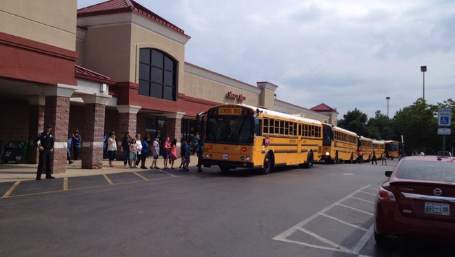 Students were loaded onto buses near Black Fox Elementary School after a bomb threat was called in at the school Friday morning.