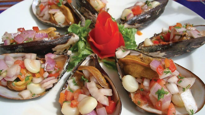 """Choros a la chalaca is an hors d'oeuvre that can be found on many Peruvian restaurant menus. Its name means """"mussels Callao-style,"""" referring to the busy Port of Callao in Peru."""
