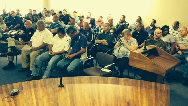 The Alexandria City Council meeting room was packed Friday, mostly with city police officers who are hoping the city will increase their pay.