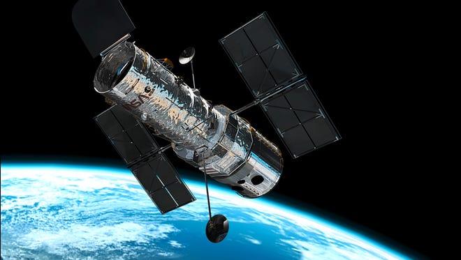 The Hubble telescope in orbit.