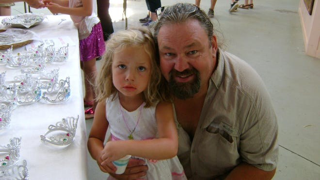 George Polley Jr. and his daughter Lucy at the Wisconsin Valley Fair in Wausau in 2014.