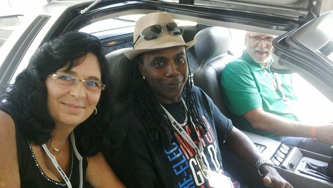 Gary and Starla Scholler, of Butler, posed with actor Donald Fullilove, who plays Goldie Wilson in Back to the Future, in their 1982 Delorean at a car show.