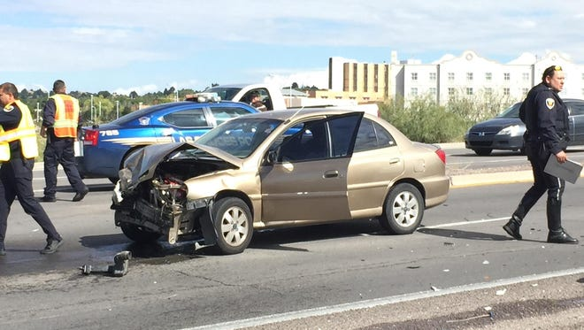 A Kia sedan was involved in a two-vehicle crash on University Avenue near Interstate 25 on Thursday in Las Cruces. The crash sparked a brief vehicle fire. The driver suffered a broken arm. The driver of the second vehicle was unharmed.