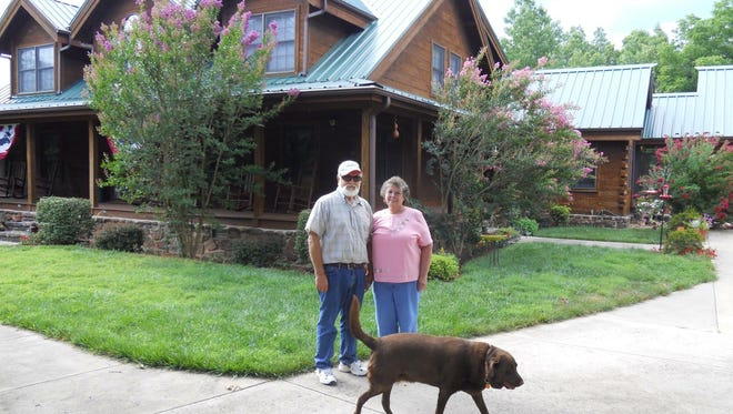 Donald and Ladonna Rice stand in front of their rural home located at 447 CR 508 near Midway in this photo believed to have been taken in 2010 by family members. The Rices' large brown dog is also shown in the photo. Family members say the Rices enjoyed the outdoors and loved their dog.