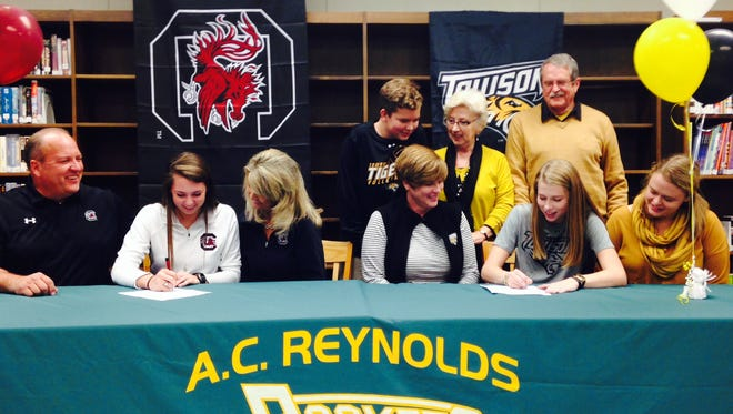 Reynolds seniors Courtney Koehler, left, and Emily Russell signed to play college volleyball on Thursday.
