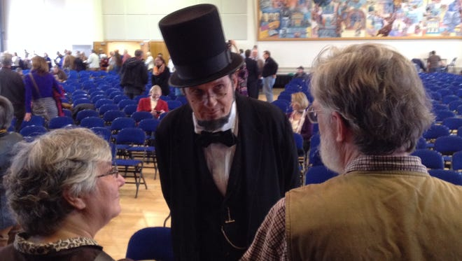 George Buss talks to members of the audience at Gettysburg's Dedication Day program.