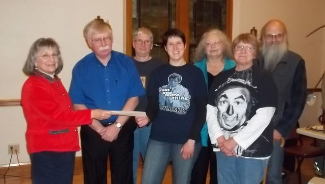 The team Just Along for the Ride won the Merrill Historical Society's Trivia Night, held Nov. 7, scoring 57 out of 80 possible points. Teams attempted to answer questions in Song Geography, Local Sports, Local History, The 1970s, Local Businesses, U.S. Citizenship, Popular Culture, and Author! Author! The winning team received a cash prize of $200. Local businesses that supported the Trivia Night fundraiser with generous donations for raffle prizes include Fun Stuff, Cosmo Theater, Los Mezcales, Merrill Golf Club, Ace Hardware, Merrill Chamber of Commerce, Sweeter Times, the Ridge Cafe at Pine Ridge Mobil, Wisconsin Institute for Public Policy, First Street Coffee Station and Lake of the Torches Resort Casino.