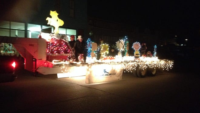The First American Bank float  featured the Peanuts gang during Saturday's Lighted Christmas Parade in Silver City.