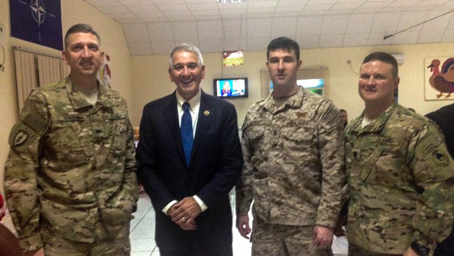 Rep. Ralph Abraham, R-La., meets in Afghanistan with soldiers from Louisiana before Thanksgiving dinner.