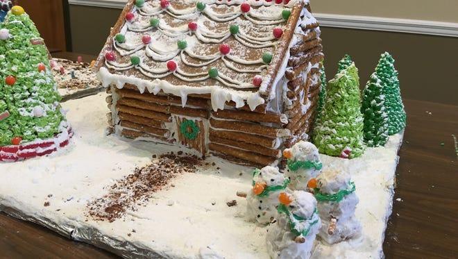 The winning Gingerbread House, made by eight grade students at Workman Middle School, Katie Munoz, Jordan Ward, and Assalla Abdelvqader.