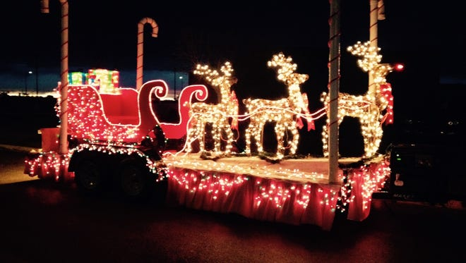 More than a dozen floats took part in the Loving Christmas Lights parade Saturday.