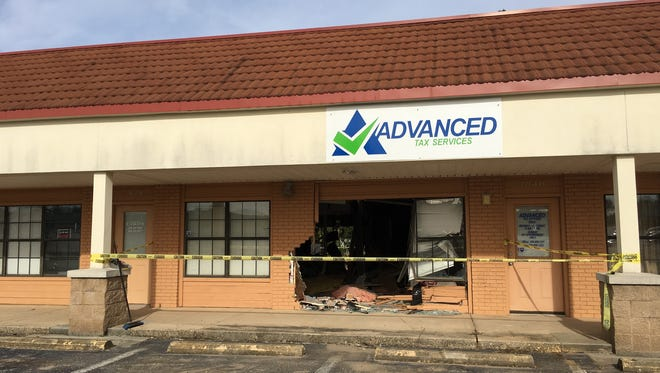 Advance Tax Services at the intersection of North Davis Highway and West Fairfield Drive was the site of a car vs. building crash at around midnight Sunday.