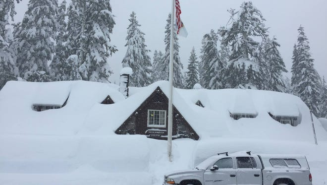 The Visitor Center at Crater Lake is covered in snow, but will still be open this holiday season.