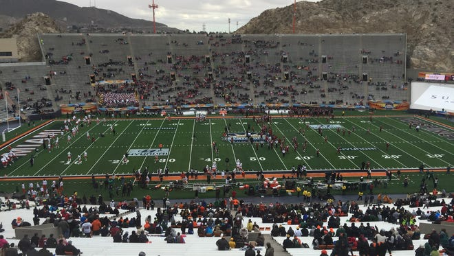 Fans bundle up and take their seats for the Hyundai Sun Bowl on Saturday at Sun Bowl Stadium.