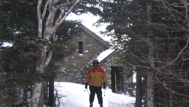 Wesley Wright of Starksboro skis away from the stone hut on Mount Mansfield during a stay there in a previous season.