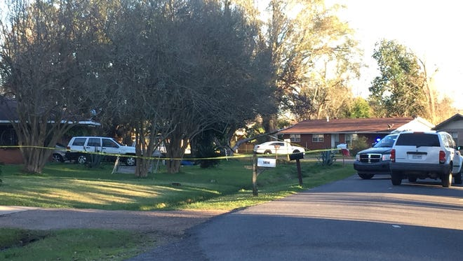 Crime scene tape surrounds an area on Marilyn Drive in Alexandria where a man shot and killed himself on Monday. The man was being chased by Rapides Parish Sheriff's deputies when he killed himself.