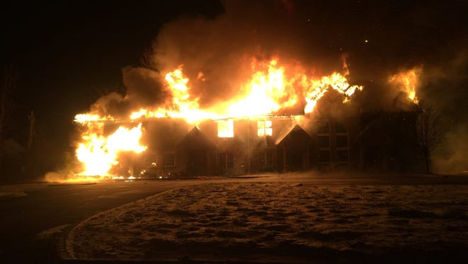 The Charlestown Crossing office complex at 3045 Charlestown Crossing Way engulfed in flames Sunday afternoon.