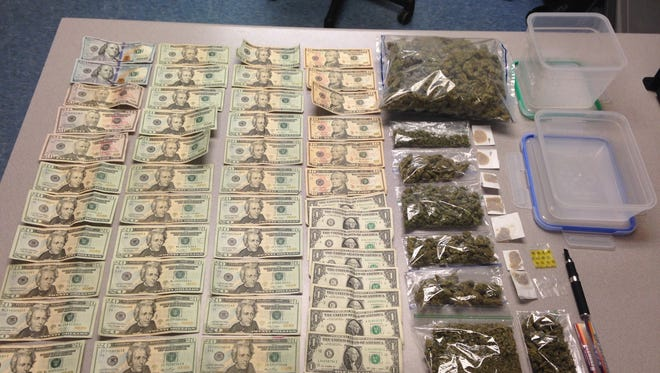 Drugs and cash confiscated in a drug bust in Mendham Township, including folds of marijuana wax, seen at right, and more than one pound of raw marijuana, Jan. 12, 2016