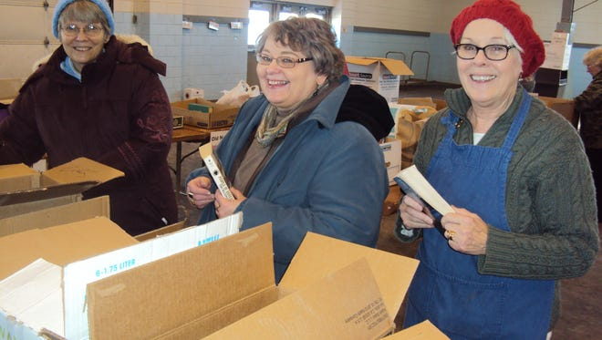 Pictured from left, Chris Arrowood, Ruth Holstein and Jane Boyle sort books for the AAUW's annual book sale.