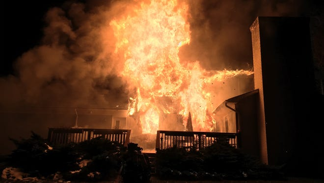 A fire consumed a house on Heartshorne Road on Valentine's Day, displacing a family of three.
