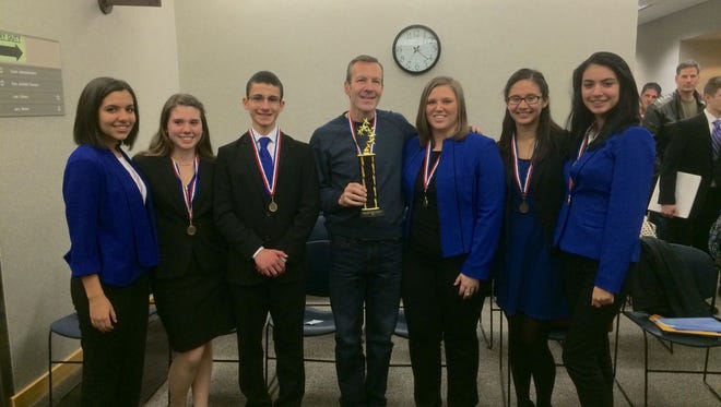 Members of the Cardinal Mooney Catholic High School mock trial team pose for a photo Saturday, March 5, 2016. The mock trial team will advance to state final March 19, 2016 in Lansing.