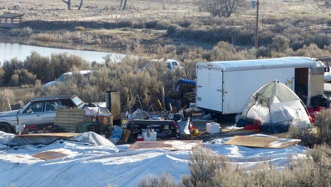 Vehicles, debris, and supplies remain Friday, Feb. 26, 2016, at what's left of Camp Finicum, the crude encampment used by the last four occupiers of the 41-day takeover of the Malheur National Wildlife Refuge outside of Burns, Oregon.