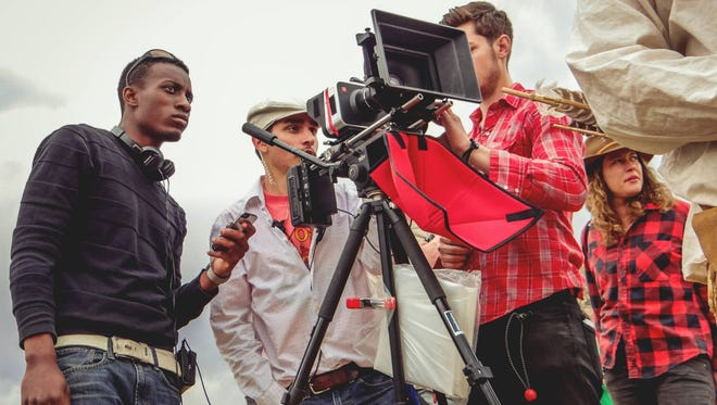 """Director Julian Alexander, left, on the set of his short film, """"Buffalo."""" Alexander is a graduate of NMSU's Creative Media Institute, and """"Buffalo"""" was recently selected to be screened at the Cannes Film Festival. Also pictured, from left to right, are crew members Andrew Griego, Dillon Glazebrook and Ilana Lapid."""