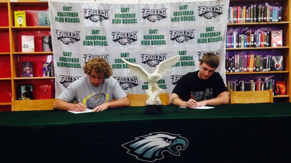 East Henderson's Trace Goldsmith, left, and Jay Spencer have signed to play college football for Mars Hill.