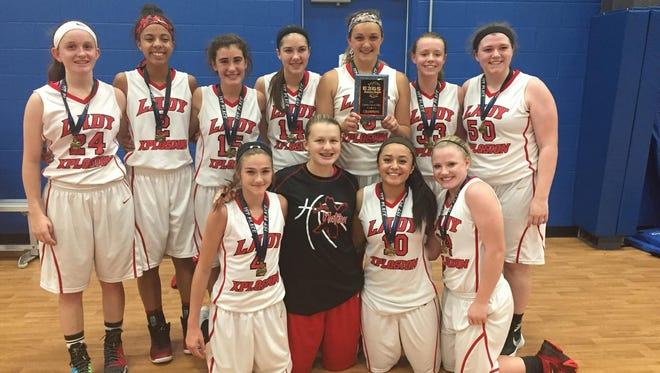 The Lady Xplosion 10th grade girls basketball team.