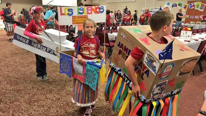 "Third-graders at Our Lady of Prompt Succor School parade Tuesday in their ""floats"" representing Louisiana festivals at the school's annual Louisiana Day celebration."
