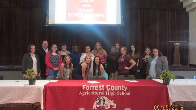 Forrest County Agricultural High School recently held a Fine Arts Signing Day Ceremony. Pictured are scholarship recipients and Andy Smigielski, director of Choral Activities at FCAHS; Lara Pitts, assistant band director at FCAHS; Lindsey Daniel, director of bands at FCAHS; and Ladona Tyson, director of choirs at PRCC.