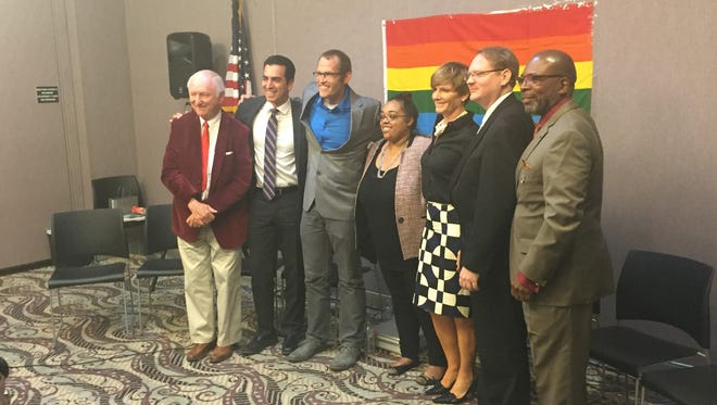Moderator Laura Martin stands with Democratic candidates (from L to R) Mike Schaefer, Ruben Kihuen, Dan Rolle, Susie Lee, Brandon Casutt, and Rodney Smith at the conclusion of Tuesday night's forum hosted by Stonewall Democrats.